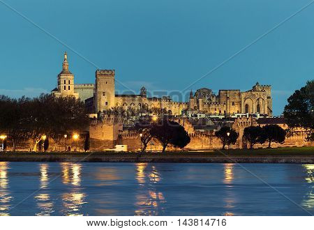 Avignon skyline. Riverside view of The Papal Palace at night one of the largest and most important medieval Gothic buildings in Europe. Provence-Alpes-Cote d'Azur. France