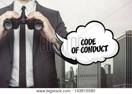 Code of conduct text on speech bubble with businessman holding binoculars on city background
