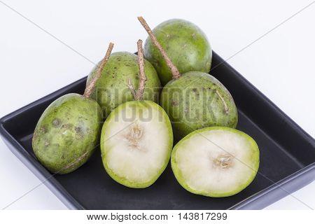 Fresh Hog Plum (wild Mango) On Black Dish