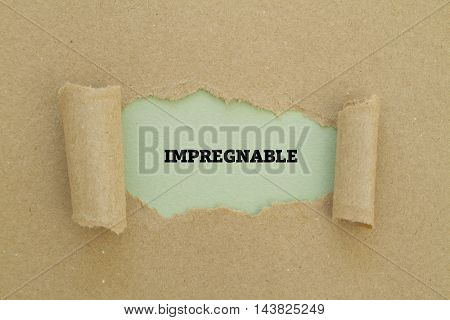 IMPREGNABLE word written under torn paper .