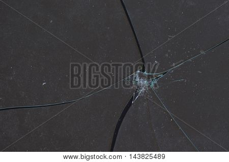 Broken piece of glass abstract background. Shattered fragile material fragments.