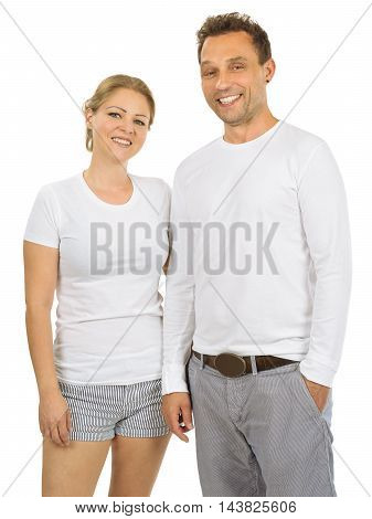 Photo of a woman and man posing with blank white shirts ready for your artwork or design.