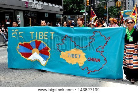 New York City - June 22 2013: Tibetan marchers at the International Immigrants Foundation Parade on Avenue of the Americas