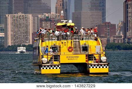 New York City - August 4 2011: Ed Rogowsky ferry boat on The Hudson River heading towards lower Manhattan