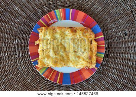 Cannelloni al forno dish closeup. Italian food pasta.
