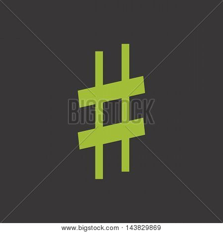Green musical symbol sharp on dark background