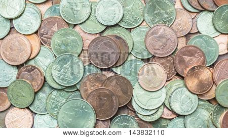Pattern of yellow and bronze Satang coins Thai currency.