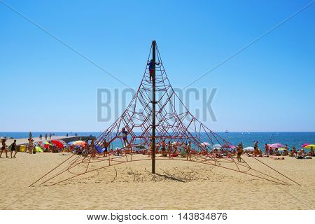 BARCELONA, SPAIN - JULY 10: People at Nova Icaria Beach on July 10, 2016 in Barcelona, Spain. This busy beach is mainly frequented by the locals