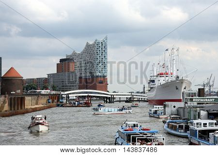 HAMBURG, GERMANY - AUGUST 20, 2016: Harbour of Hamburg, Elbphilharmonie (new philharmonic orchestra hall), museum ship old steamer Cap San Diego.