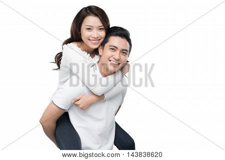 Copy-spaced portrait of a young couple in-love smiling and looking at camera