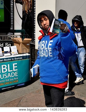 New York City - March 27, 2014:: Asian youth distributing religious flyers during a Bible Crusade on West 34th Street in Herald Square