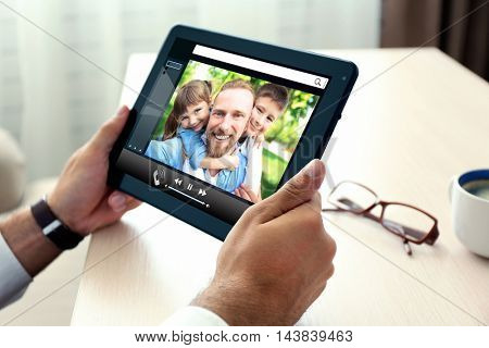 Video call and chat concept. Modern communication technology. Man video conferencing on tablet.