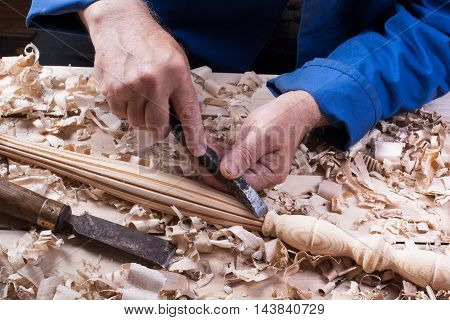 Carpenter working with plane on wooden background at Building Site. Joiner workplace