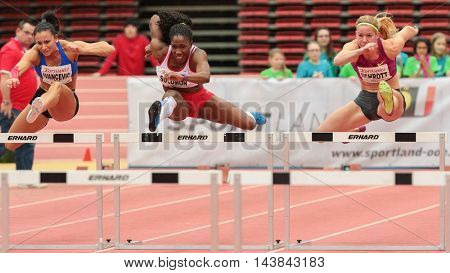 LINZ, AUSTRIA - FEBRUARY 6, 2015: Beate Schrott (#352 Austria) competes in the women's 60m hurdles event in an indoor track and field event.