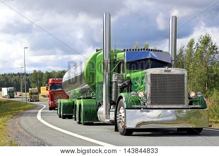LEMPAALA, FINLAND - AUGUST 11, 2016: Peterbilt 359 year 1971 of Fredrik Biehl exits freeway in truck convoy on the way to the annual trucking event Power Truck Show 2016 in Alaharma Finland.