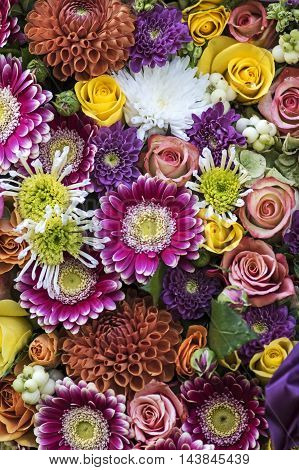 Bouquet with several sorts of flowers in the Color of fall