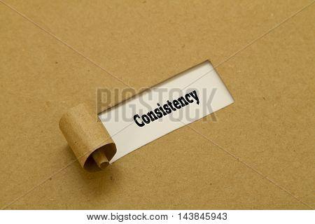 Consistency word written under torn paper .