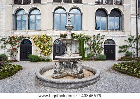 Varenna Italy - May 06 2016: The fountain in a garden of Villa Monastero spring time