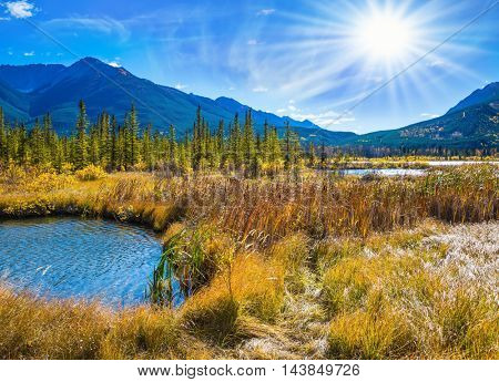 Gorgeous sunset on the Vermilion Lakes in mountains of Banff National Park. Concept of ecotourism. Rocky Mountains, Canada