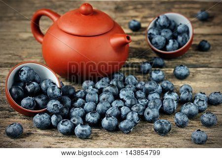 Freshly picked blueberries. Juicy and fresh blueberries. Bilberry on wooden background. Blueberry antioxidant. Concept for healthy eating and nutrition selective focus