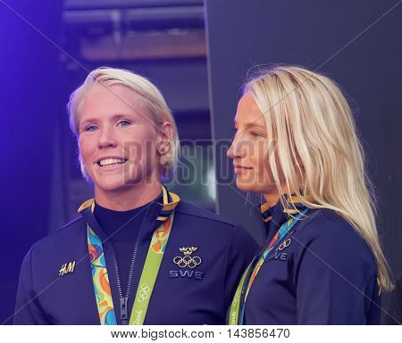 STOCKHOLM SWEDEN - AUG 21 2016: Happy swedish female wrestler Jenny Fransson and Sofia Mattson when swedish olympic athletes are celebrated in Kungstradgarden