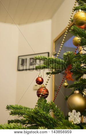 Christmas tree sel decorated inside a home