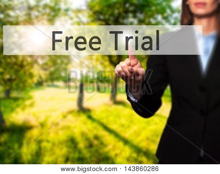 Free Trial - Businesswoman Pressing Modern  Buttons On A Virtual Screen