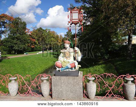 TSARSKOYE SELO, RUSSIA - SEPTEMBER 21, 2012: Photo of Sculptures on the big Chinese bridge in Alexander Park, Tsarskoye Selo