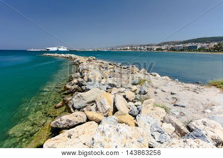 Rethymnon, Island Crete, Greece, - July 1, 2016: View of the artificial cape made from stones and harbor. Rethymnon is an old historic town on the northern coast of the island Crete.