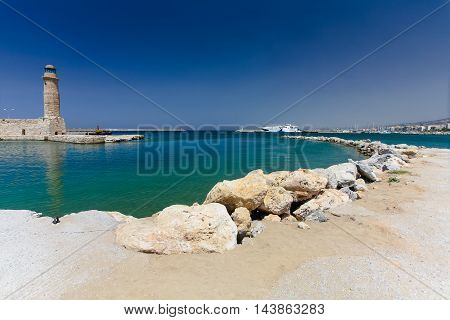 Rethymnon, Island Crete, Greece, - July 1, 2016: Old venetian lighthouse and harbor. Rethymnon is an old historic town on the northern coast of the island Crete.