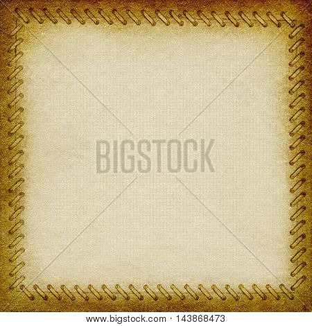 Gold crumpled paper with frame in the form of binding. Paper into the cell with space for an inscription. Background texture for your message