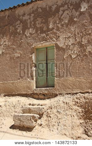 The door and steps of an old dilapidated house in Bolivia, El Alto, La Paz, Altiplano