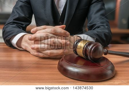Lawyer Has Clasped Hands And Gavel In Front. Justice And Law Con
