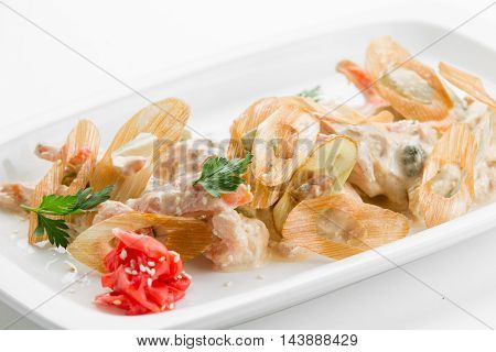 Sauteed tiger prawns in a sauce Ber Blanc on white plate background