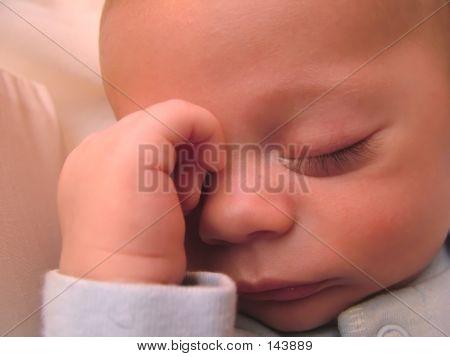 Sleeping Baby With Hand On Head