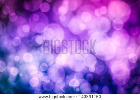 Defocused bokeh. Twinkling light purple bokeh abstract background for Christmas and Happy new year holiday. Festive elegant blurred background with bokeh circular and bright light.