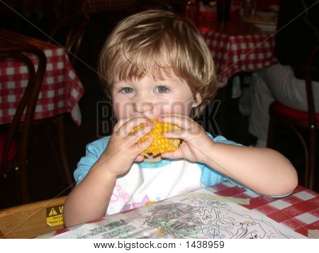 Toddler Eating Corn On The Cob