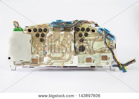 Back view of car speedometer with electric wiring on white background