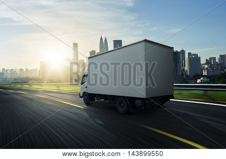 Transport truck on the road in the morning .