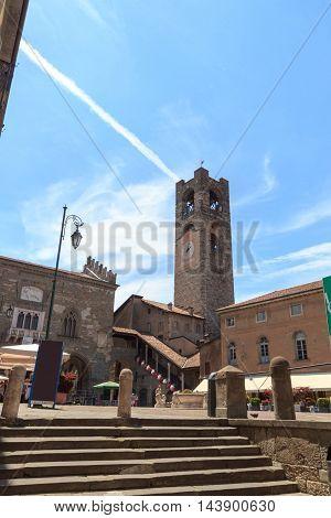 Town square Piazza Vecchia and old city tower Torre Civica in Bergamo Citta Alta Italy