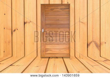 Wooden door in the middle of the wooden floor.
