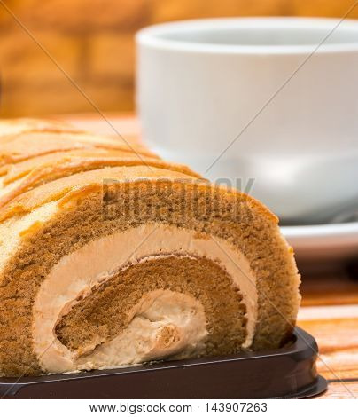 Swiss Roll Represents Coffee Shop And Barista