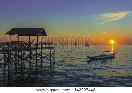 Sunset at the pier Biringkassi traditional society Pangkajene Islands Regency South Sulawesi.