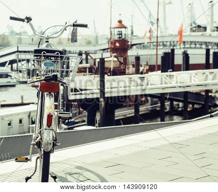 post card city view from vintage bicycle, riverside Germany, Hamburg close ap