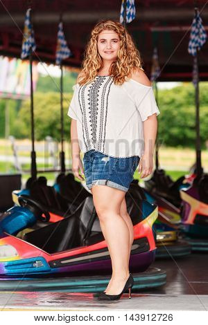 Trendy woman with oversize and blonde curls with a summer casual wear
