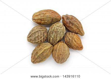Organic dry Harad (Terminalia chebula) isolated on white background. Macro close up. Top view.