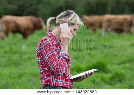 portrait of female Farmer managing her farm
