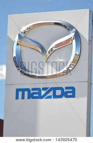 CIRCA AUGUST 2016 - GDANSK: Logo of Mazda. Mazda Motor Corporation is Japanese automaker based in Fuchu, Japan. Mazda was founded in 1920 by Jujiro Matsuda.