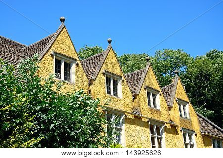 Cotswold cottage with dormer windows in the village centre Castle Combe Wiltshire England UK Western Europe.