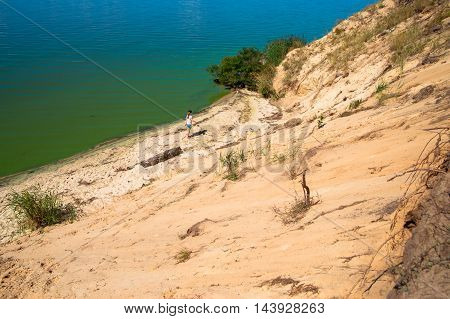 a little girl goes on the bank of great lake